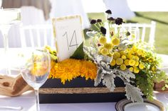 floral centerpiece with table number.