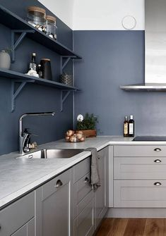 Kitchen in warm grey and petrol blue - via Coco Lapine Design blog