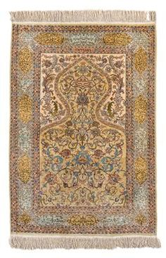 Hereke silk,Northwest Anatolia (Turkey), c. 147 x 105 cm, second half of the 20th century prayer rug with rare mint-green background, cartouches with inscriptions, Hereke signature on the upper inner border, c. 1 mill. kts/sqm with embedded metal threads - excellent condition. (MA)