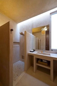 Hacienda Sac Chich by Reyes Ríos Larraín Arquitectos bathroom with naturel design, nice light. Original shower