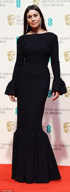 Double 'O' heaven: Bond girl Monica Bellucci showed off her curves in a black fishtail number