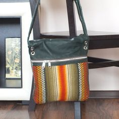 This is a #handwoven ladies #foldover #bag, shoulder #bag, #crossbody bag made of 100% hand-spun natural wool and leather. This bag is made with the use of traditional techniques and the finest of leathers sourced to create this modern bag with handwoven rug elements. The inside is made of high quality lining, there is a small inner pocket with zipper for your small personal belongings and outer zipper pocket. Zipper closure, leather adjustable straps.