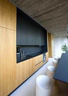 A very chic kitchen with black and natural wood. Perfect for any house but more for our single males out there.