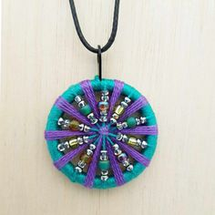 Handcrafted using rich teal and purple cotton threads with beautiful light reflecting seed beads.  Finished with a waxed cotton cord, lobster claw clasp and extension chain. Pendant approx. 40mm diameter, cord length approx 45cm. Check out my Etsy shop for more info and my range of handcrafted bags, purses and accesories. #women's jewellery #beaded necklace #fashion accessory  Diy Buttons, How To Make Buttons, Dorset Buttons, Heritage Crafts, Passementerie, Embroidery Hoop Art, Beading Projects, Handmade Beads, Scrapbooking