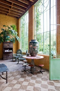"Inside seven beautifully eccentric homes: Interior designer Jean-Philippe Demeyer lives in an old homestead on the estate of Sint-Kruis Castle, just outside Bruges. He also uses the space, which dates back to the 13th Century, as his showroom. Demeyer describes his style as ""minimalist maximalist"", in other words, he would prefer to have fewer pieces of furniture, but monumental in size."