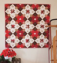 I love this star quilt kit in the gorgeous chocolate, red and cream. Super fun pieced quilt to do! #quilting #patchwork #pattern