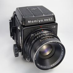 Mamiya RB67 I had one and carried around Europe...two backs, light meter, rolls of 120 film...amazing time