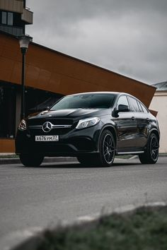 Shallow focus photo of black Mercedes Benz sedan  Cars
