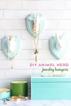 """How to make whimsical DIY jewelry hangers using decorative animal heads and wood plaques. A cute """"faux taxidermy"""" craft idea."""