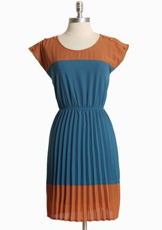 """Country Club Pleated Dress 46.99 at shopruche.com. Burnt orange and blue are paired to create this delightfully understated dress. Finished with decorative buttons, a beautiful sunburst pleated skirt, and an elasticized waist for a flattering and comfortable fit. Fully lined.100% Polyester, Imported, 35.5"""" length from top of shoulders"""