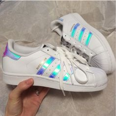 Superstar hologram sneaker shoes white rainbow These will fit women's 8 :) I walked into footlocker to get these. Low cut iridescent rainbow stripe white New sneakers in original box! Big kids 6.0/ mens 5.0/ women's 7.0. These run 1 size big and fit women 8) ! I tried them on with socks once, and out right back into box. They are too big for me, I'm a 7.5 and wear a big kids 5.5 perfect :) Adidas Shoes Sneakers