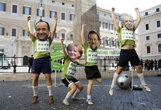 Demonstrators wearing masks depicting European leaders simulate playing a soccer match to protest against the euro zone debt crisis, in front of the Chigi palace in Rome, Italy.