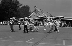 """Spring """"World in Dance"""" festival at Harding St. Elementary School. First, second, and third graders at Harding Street Elementary School in Sylmar participate in a Maypole dance. San Fernando Valley History Digital Library."""