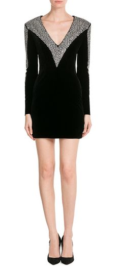 A generous shower of glass beads covers the sleeves and shoulders of this Balmain dress, adding a glamorous edge to the high hemline and pitch black color. We love the dramatic V-neckline as a party-appropriate finish #Stylebop
