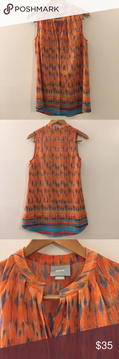 Anthropologie Maeve tunic This top is in excellent condition! Bright and beautiful! 98% polyester 2% spandex. Dry clean. 28 inches in length. 19 1/2 inches across the bust. Buttons down the front. Non-smoking pet free home.                                                           🔹suggested user • fast shipper🔹                       🔸bundle to save 15%🔸 Anthropologie Tops Tunics