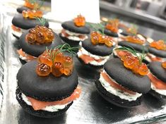Squid ink macarons with smoked salmon, lemon dill creme fraiche and ikura. Happy Kitchen, Tasty Bites, Creme Fraiche, Smoked Salmon, Canapes, Macaroons, Catering, Cheesecake, Good Food
