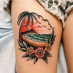Traditional beach landscape tattoo with the flowers inked on the left upper thigh