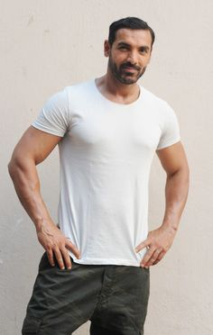 John Abraham Photos - Indian Bollywood actor John Abraham poses during the announcement for the Hindi film Dishoom directed by Rohit Dhawan and produced by Sajid Nadiadwala,in Mumbai on April / AFP / STR - Bollywood Actors Present Hindi Film 'Dishoom' Indian Bollywood Actors, Bollywood Stars, Bollywood Celebrities, Male Celebrities, India Actor, Famous Indian Actors, Dishoom, John Abraham, Celebrity Biographies