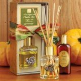 """Aromatique Pumpkin Spice Reed Diffuser Set with Emblem by Aromatique. $28.95. Gift Boxed. Size: 5 fl oz / 148ml oil, reeds 9.5"""". Aromatique Pumpkin Spice embodies a warm fragrance with vibrant fall foliage with this Pumpkin Spice Reed Diffuser Set with Emblem. This square shape glass bottle with attached metal copper cornucopia medallion holds this fragrant delight."""