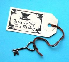 Great idea for invitations. Swing tag with key