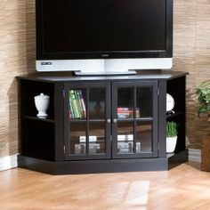 """Davenport Corner Media Stand for TVs up to 42"""" - Walmart.com $287 Traditional style 2 doors 2 shelves Cord management system Accommodates a flat panel TV up to 42"""" Room for audio and visual components Wood construction Pewter hardware  Assembly required Unit Dimensions: 46""""W x 22.25""""D x 24""""H Center Cabinet Dimensions: 24""""W x 20""""D x 20""""H Side Storage Dimensions: 12.5""""W x 12""""D x 20""""H Model #WM197722"""