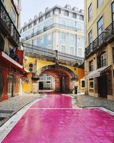 Rua Nova do Carvalho, the famous pink street of Lisbon, Portugal 🇵🇹️ Places Around The World, The Places Youll Go, Travel Around The World, Places To Go, Around The Worlds, Places In Portugal, Visit Portugal, Portugal Travel, Pink Street