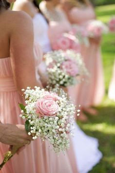 A single rose or seasonal flower with some baby's breath would be nice for bridesmaids (not pink though)