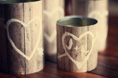 wooden vase/centerpiece: cans + wood design scrapbook paper & white paint marker.