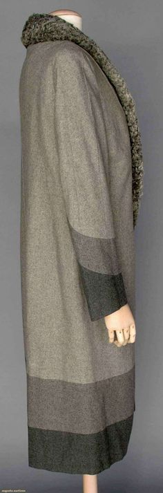 DECO SPRING WOOL COAT, 1928 Light gray wool flannel, 3/4 length, gray curly lamb shawl collar, sleeve & hem w/ inset curved bands of darker gray & charcoal wool flannel, unusual seaming on back of coat, gray silk lining w/ hidden pocket