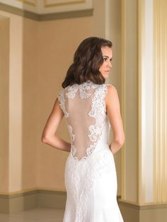 Justin Alexander Style 8867 features a beautiful illusion back.