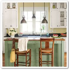 Like the yellow walls and white cabinets...maybe blue instead of green on the island. BLS