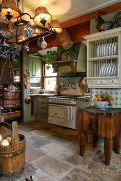 A bit too rustic for me, but it has some nice elements. I like the green cabinets and the white dish rack. The butcher block is cool, but basically useless.