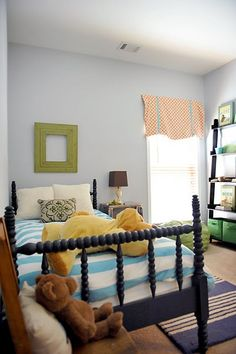 Love the spindle bed in navy. Great kid room. Great bedroom for boys.