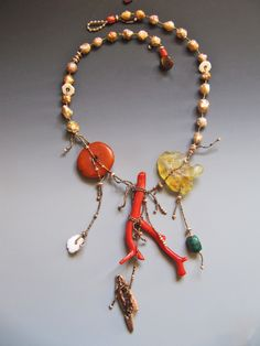 Branch coral, antique African amber, antique Tibetan turquoise, antique shell from North Africa, re purposed walrus ivory, rosebud fresh water pearls LuciaAntonelli.com
