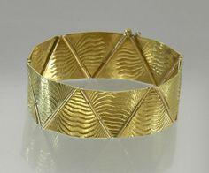 Bracelet in gold, cuttlefish bone cast links, by Nancy Shapiro.