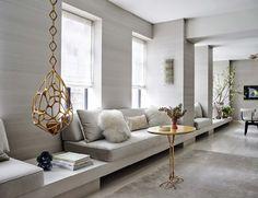 Bold Manhattan Pied-A-Terre in a elegant combination of neutrals and gold. #elegant #combination #neutrals #gold #grey #sofa