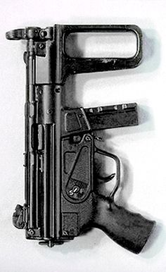First prototype of the MP5K, produced in 1976.  The first version of the foregrip was made of wood, and was subsequently reduced in size to aid in concealability.  This foregrip was made from wood.