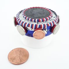 """Jar #51 (out of 366) from the """"365 Days of Lip Service project."""" Polymer Clay, rubbing of a quarter and micro coins; http://lisapavelka.typepad.com"""