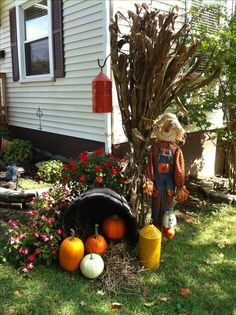 Outdoor fall decorating; latern on shephards hook