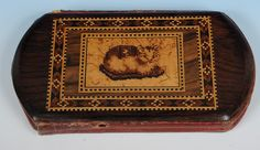 One for the animal lovers, a rare leather cheroot case with rosewood panels inlaid on both sides and featuring the mosaic of a cat and a dog. Offered by Amherst Antiques at The Edenbridge Galleries, Kent. www.edenbridgegalleries.com