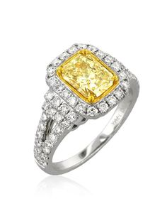 I love this!!!!  Jenny McCarthy's Yellow Sapphire Engagement Ring. Emerald cut citron diamond ring.
