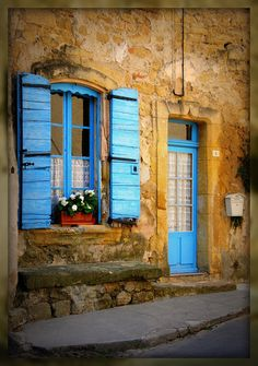 Bright turquoise color next to the stone walls just makes me happy. Beautiful Streets, Beautiful Places, Tudor Cottage, Window Shutters, Provence France, Rhone, Facade Architecture, South Of France, France Travel