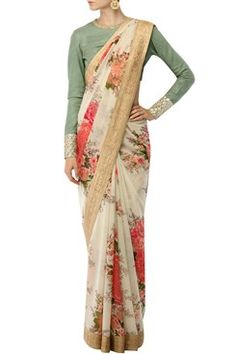 An ivory base georgette saree with shades of pink flower bunches print all over. It has a blush pink ang gold banarasi border. It is paired with a pista green thread work textured khadi blouse with gold sequin and dori work on sleeves. Shop Now at www.carmaonlineshop.com #carma #carmaonlineshop #indian #designer #indianwear #Sabyasachi #ethnicwear #fashion #saree #style #ethnic #shopnow #onlineshopping