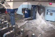 Floodwaters from Hurricane Sandy rush into the Port Authority Trans-Hudson's (PATH) Hoboken, New Jersey station through an elevator shaft.