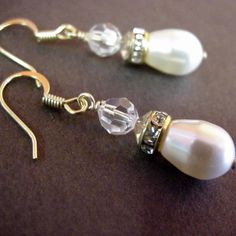 These satiny smooth teardrop shaped pearl earrings are the essence of elegance when paired with sparkling Swarovski crystals. Perfect for bridal jewelry. Teardrop Pearl Earrings, Crystal Earrings, Crystal Jewelry, Drop Earrings, Bridal Earrings, Bridal Jewelry, 15th Wedding Anniversary Gift, Jewelry Stores, Swarovski Crystals