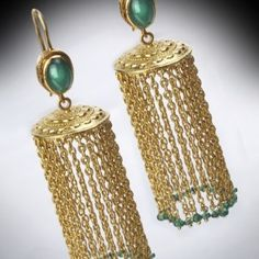 Gehna offer to showcasing Rich emerald green gemstones and a decorative tassle handcrafted 18k gold forms this pair of contemporary jhumkis online in Chennai.