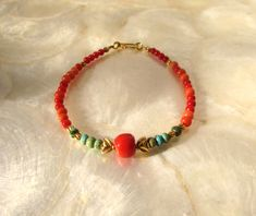 bracelet with antique vintage natural coral beads Gleeson turquoise beads and solid gold 18 karat 18k by ColouredCat on Etsy https://www.etsy.com/listing/477778249/bracelet-with-antique-vintage-natural
