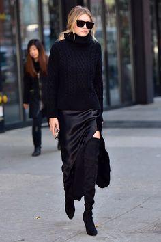 Gigi Hadid black silk long skirt and thigh high boots with chunky sweater km