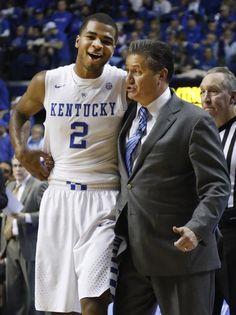 Kentucky's Aaron Harrison (2) is hugged by head coach John Calipari late in the second half of an NCAA college basketball game with Vanderbilt in Lexington, Ky., Tuesday, Jan. 20, 2015. Kentucky won 65-57