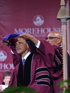 US President Barack Obama is presented with and honorary doctor of law degree after delivering the commencement address during a ceremony at Morehouse College on May 19, 2013 in Atlanta, Georgia. AFP PHOTO/Mandel NGAN (Photo credit should read MANDEL NGAN/AFP/Getty Images)